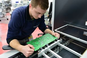 The inspection process in the manufacture of printed circuit boards at Ziehl-Abegg is fully automated but if the machine identifies any anomalies then employees like Vitalij Fofonov check the boards.
